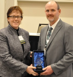 Mickey Dietrich accepting the 2015 GIS Champion award on behalf of Tim Turck, the Superintendent of Public Works for the Village of West Carthage.