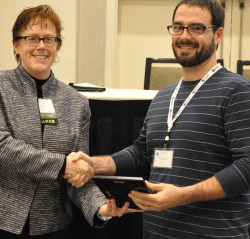 Tom Hynes accepting the 2105 Applications Award on behalf of the Ulster County GIS program for the re-launch of Ulster County's REConnect, an Interactive Web-Mapping Tool.