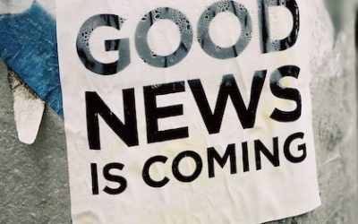 Sign with words good news is coming